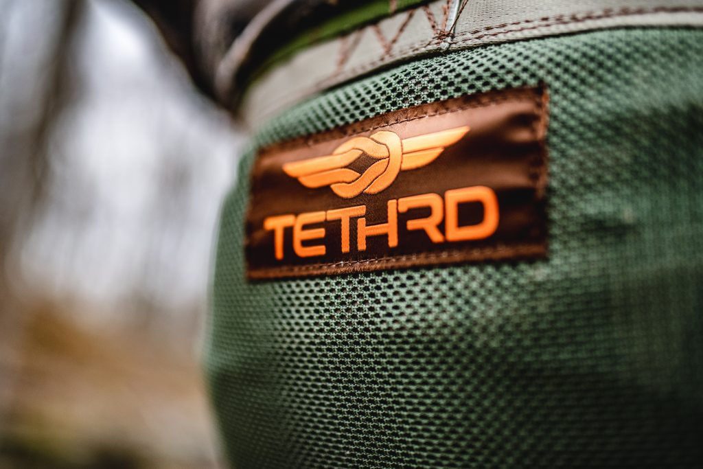 tethrd saddle hunting gear logo